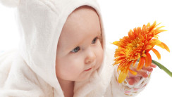 Cute Baby Girl With Orange Flower Photography Gallery
