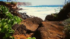 Photo of Rocks at Edge of Ocean HD Wallpaper